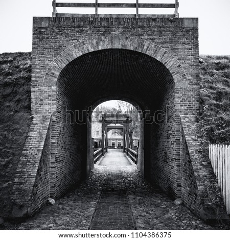 Black and white picture of the access bridge to Bourtange, a Dutch fortified village in the province of Groningen  in the north of the Netherlands