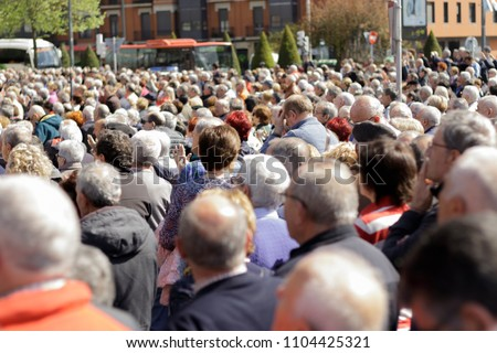 Multitude of adult people carrying out a strike or demonstration outside the public administrations in Europe. Strike for increase of Life Pensions #1104425321