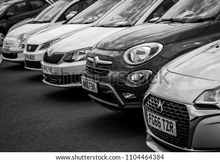 This photo was taken in Derby, Derbyshire / United Kingdom - May 27, 2018: A line of modern cars. #1104464384