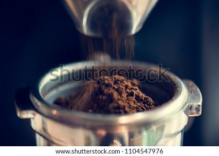 Closeup of fresh grinding coffee #1104547976