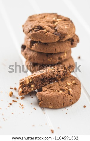 Tasty chocolate cookies on white table. #1104591332
