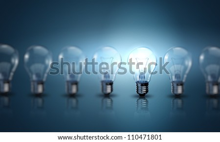 Light bulb lamps on a colour background Royalty-Free Stock Photo #110471801