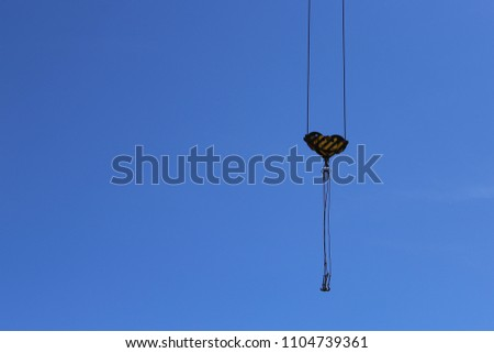 Construction crane against the blue sky. #1104739361