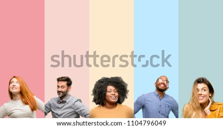Cool group of people, woman and man confident and happy with a big natural smile laughing #1104796049