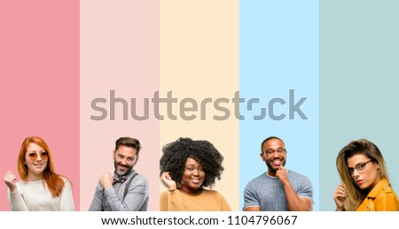 Cool group of people, woman and man confident and happy with a big natural smile laughing #1104796067