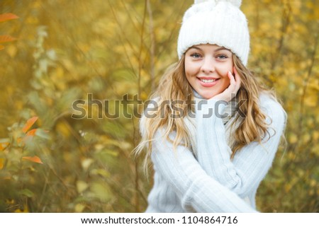 Young attractive woman in autumn colorful background #1104864716