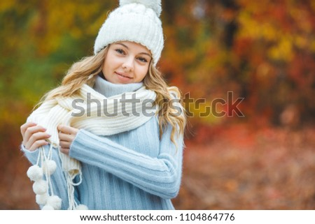 Young attractive woman in autumn colorful background #1104864776