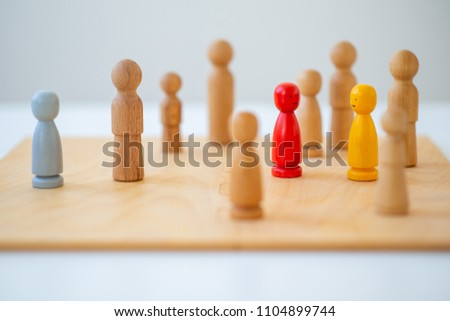 systemic board, family therapy, concept, psychotherapy wooden figures, people, team constellation, posing Royalty-Free Stock Photo #1104899744