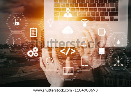 Coding software developer work with augmented reality dashboard computer icons of scrum agile development and code fork and versioning with responsive cybersecurity.Businessman hand working  VR screen #1104908693