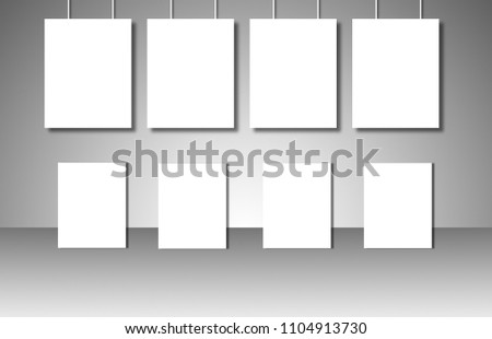 Empty white posters on gray background #1104913730