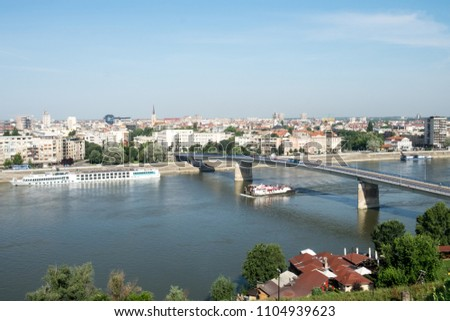 The panoramic cityscape of famous cultural capital of Serbia, Novi Sad, the Danube river with the bridge across it from the ancient military fortress Petrovaradin #1104939623