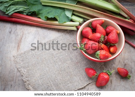 Strawberry and rhubarb on a table #1104940589
