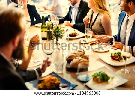 Group of diverse friends having a dinner #1104963008