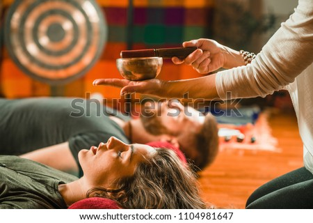 Tibetan singing bowl in sound therapy Royalty-Free Stock Photo #1104981647