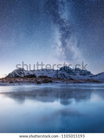 Night sky and reflection on the frozen lake. Natural landscape in the Norway #1105015193