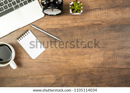 Laptop and office stationary or office supplies with copy space on wood table background. #1105114034