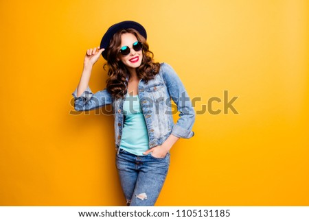 Portrait of charming pretty coquette holding hand in pocket and on hat having modern hairdo fashionable look isolated on yellow background with copy space empty place #1105131185