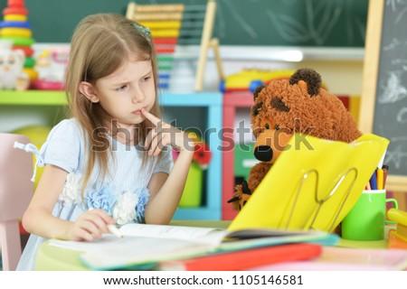 Cute little schoolgirl at home #1105146581