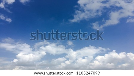 Beautiful clouds against a blue sky background. Cloud sky. Blue sky with cloudy weather, nature cloud. White clouds, blue sky and sun #1105247099