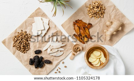 A collection of natural raw herbal ingredients as part of an herbal tonic formula used in Traditional Chinese Medicine (TCM) for cold and flu. #1105324178