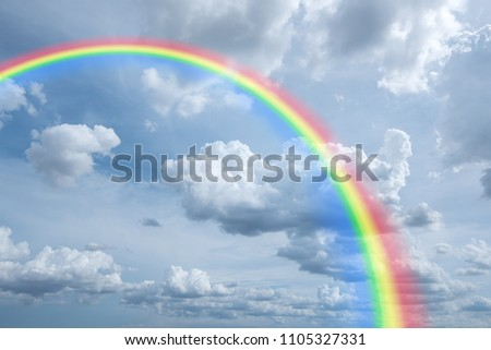 rainbow in cloudy sky for background