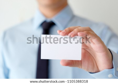 Businessman hand holding blank white business card with copy space for text, business mock up background concept  #1105388318