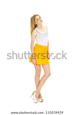 Attractive  slim girl in full growth on a white background #110539439