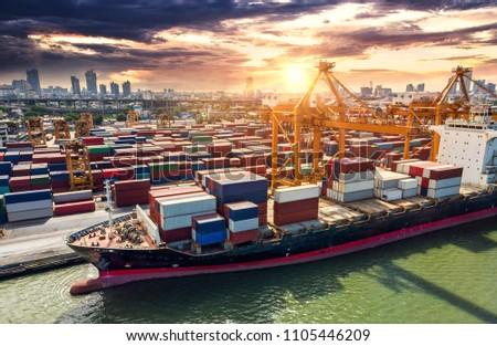 Logistics and transportation of Container Cargo ship and Cargo plane with working crane bridge in shipyard at sunrise, logistic import export and transport industry background #1105446209