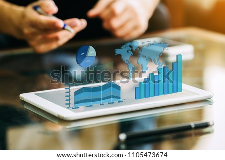 businessman investment consultant analyzing company financial report balance sheet statement working with digital graphs. Concept picture for stock market, office, tax,and project. 3D illustration. #1105473674