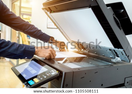 Bussiness man Hand press button on panel of printer, printer scanner laser office copy machine supplies start concept. Royalty-Free Stock Photo #1105508111