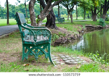 The chair in the garden near the pond #110573759