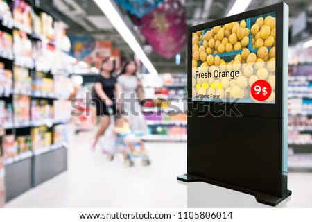 Intelligent Digital Signage , Augmented reality marketing and face recognition concept. Interactive artificial intelligence digital advertisement fresh orange organic farm in retail shopping Mall.