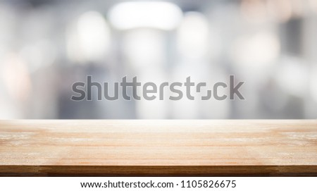empty brown wooden table and interior blur background with bokeh image, for product display montage. Selected focus #1105826675