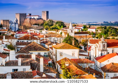 Obidos, Portugal stonewalled city with medieval fortress, sunset light. #1105827533