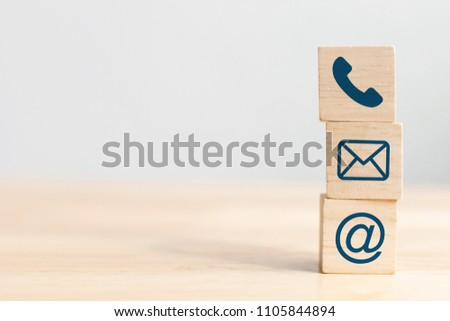 Wooden block cube symbol telephone, email, address. Website page contact us or e-mail marketing concept #1105844894