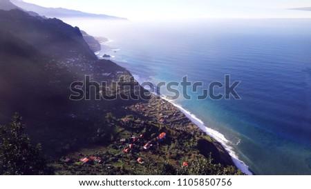 view of small town on the seashore #1105850756