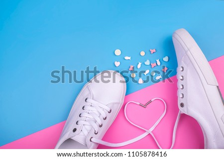 Fashion Trendy White Sneakers with Heart. Pastel Pink Blue Color.   Minimal Style. Summer Floral Sneakers. Flat lay.  #1105878416