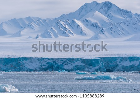 norway landscape ice nature of the glacier mountains of Spitsbergen Longyearbyen  Svalbard   arctic ocean winter  polar day sunset sky Royalty-Free Stock Photo #1105888289