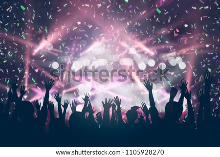 Party Background - Crowd People Enjoying in DJ Concert with Confetti Lighting and Laser #1105928270