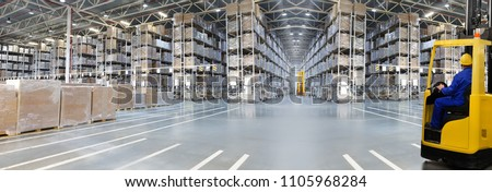 Huge distribution warehouse with high shelves and loaders. Bottom view. #1105968284