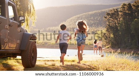 Excited Family Reaching Countryside Destination On Road Trip Royalty-Free Stock Photo #1106000936