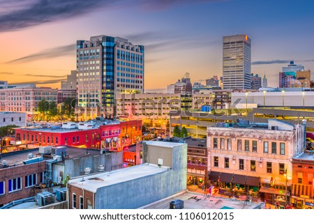 Memphis, Tennessee, USA city skyline over Beale Street at dusk.