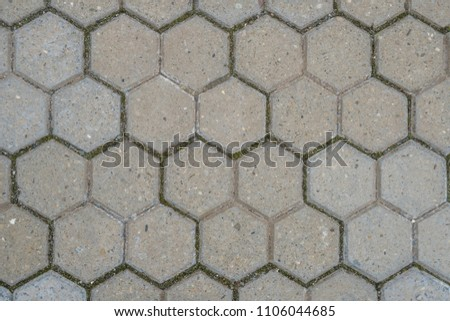 Stone pavement texture. Abstract background of old cobblestone pavement. #1106044685