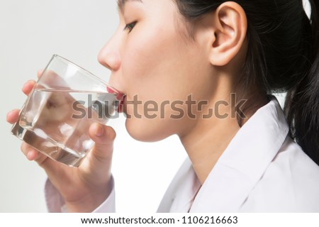 Young Asian woman drinking water #1106216663