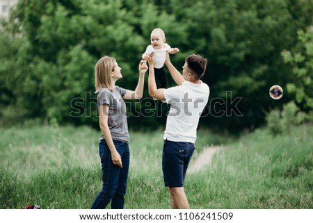 Parents and daughter family portrait. Daddy, mom and child having fun outdoors. Father's day, Mother's day, loving parents, childhood, fatherhood, motherhood, love, happiness #1106241509
