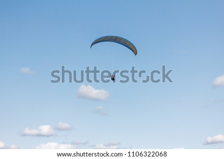 Paraglider flying sport, wing in blue sky #1106322068