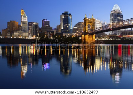 Cincinnati skyline. Image of Cincinnati and John A. Roebling Suspension Bridge at twilight.