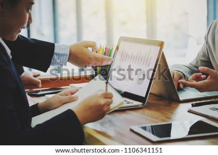 Business people discussing project in laptop and financial planning concept. #1106341151