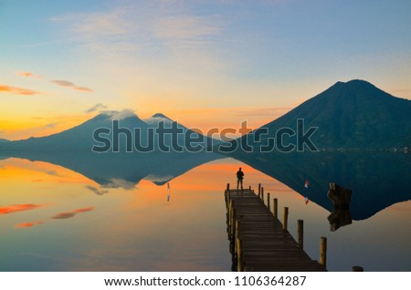 Observing the incredible beautiful sunrise at Lake Atitlan in Guatemala. #1106364287
