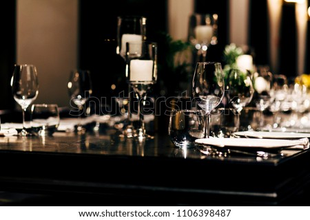 Luxury table settings for fine dining with and glassware, beautiful blurred  background. For events, weddings. #1106398487